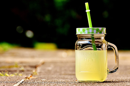 drink with plastic reusable straw
